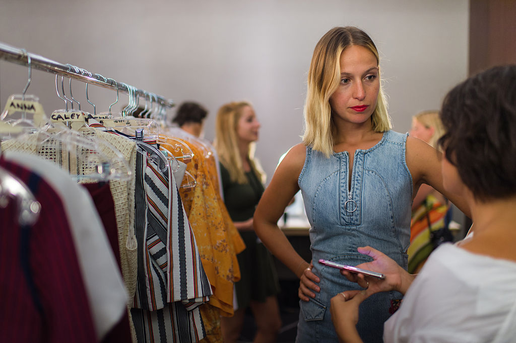 Misha Nonoo prepares backstage at the CFDA Incubator show and cocktail party at W South Beach For SWIMMIAMI 2016 on July 18, 2015.