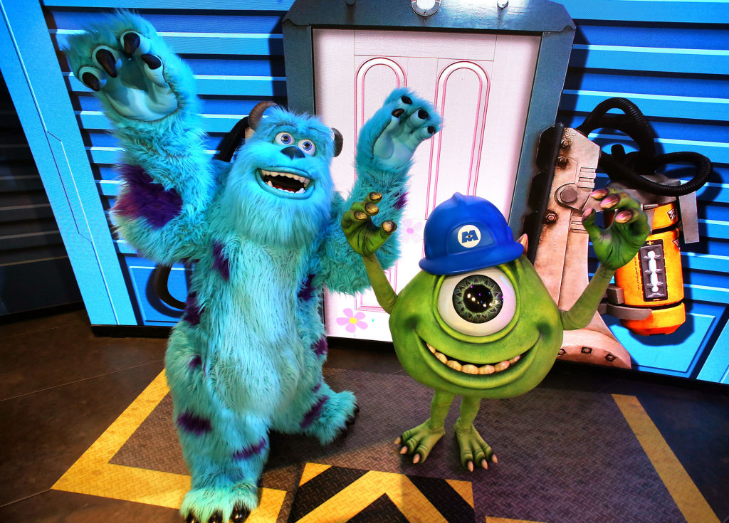 Pixar characters Mike Wazowski, right, and Sulley greet guests at the debut of  An Incredible Celebration  at Disney's Hollywood Studios at Walt Disney World in Lake Buena Vista, Fla., on January 18, 2018. The new character interaction encourages guests to meet and dance with the stars of Pixel movies, including the Incredibles, Frozone, Mike & Sulley from Monsters, Inc., and super-suit designer Edna Mode. (Joe Burbank/Orlando Sentinel/Tribune News Service via Getty Images)