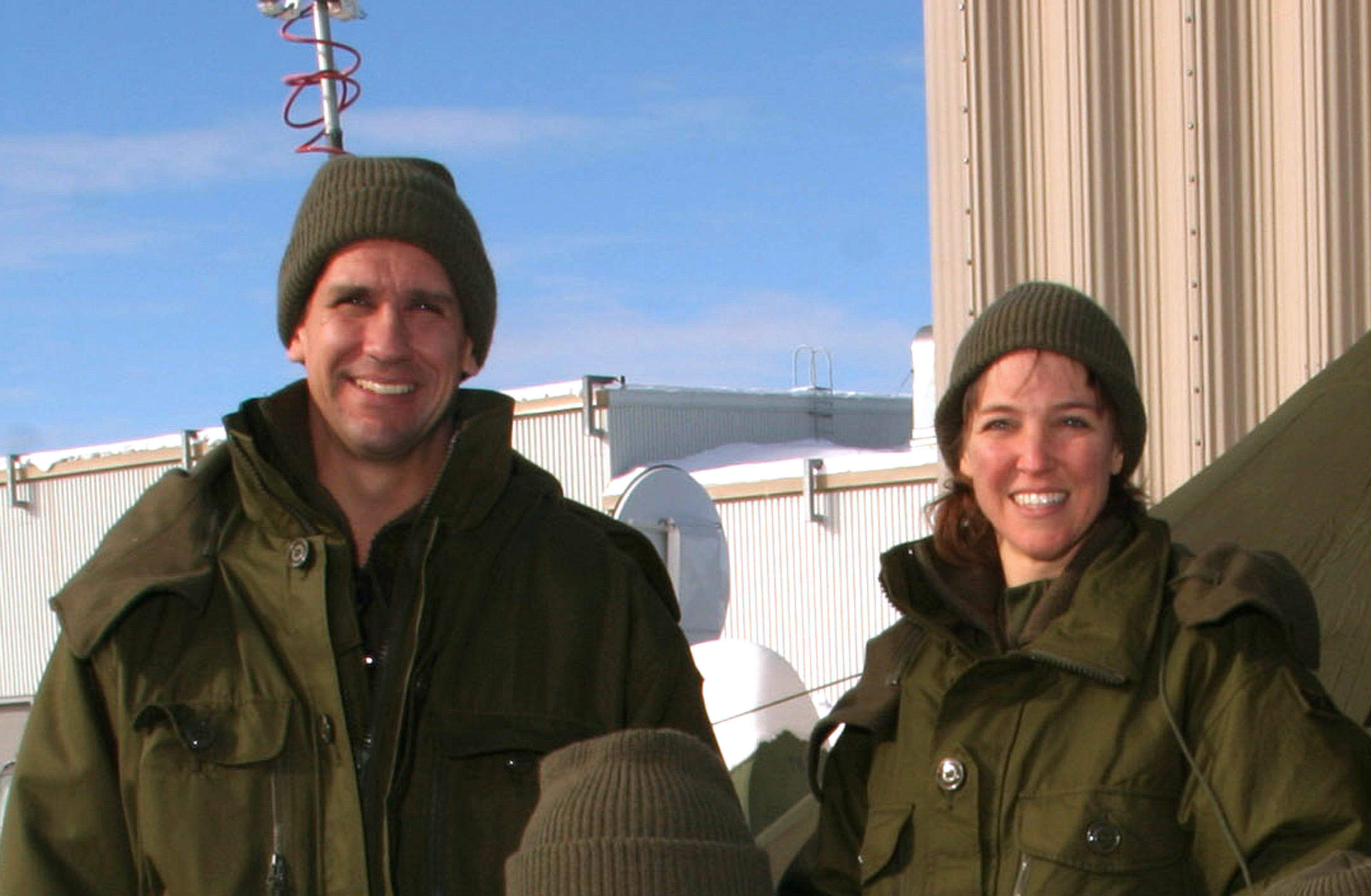 William Oefelein of NASA, left, and Lisa Nowak of NASA pose during winter training in Valcartier, Quebec, Canada, Jan. 21, 2004.