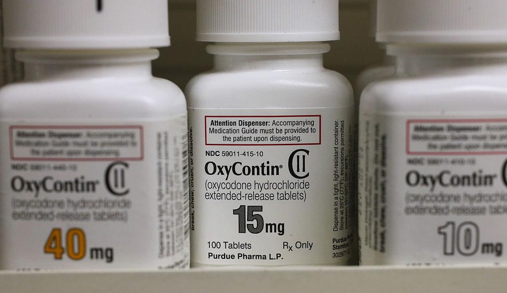 Bottles of Purdue Pharma L.P. OxyContin medication sit on a pharmacy shelf in Provo, Utah, U.S., on Wednesday, Aug. 31, 2016.