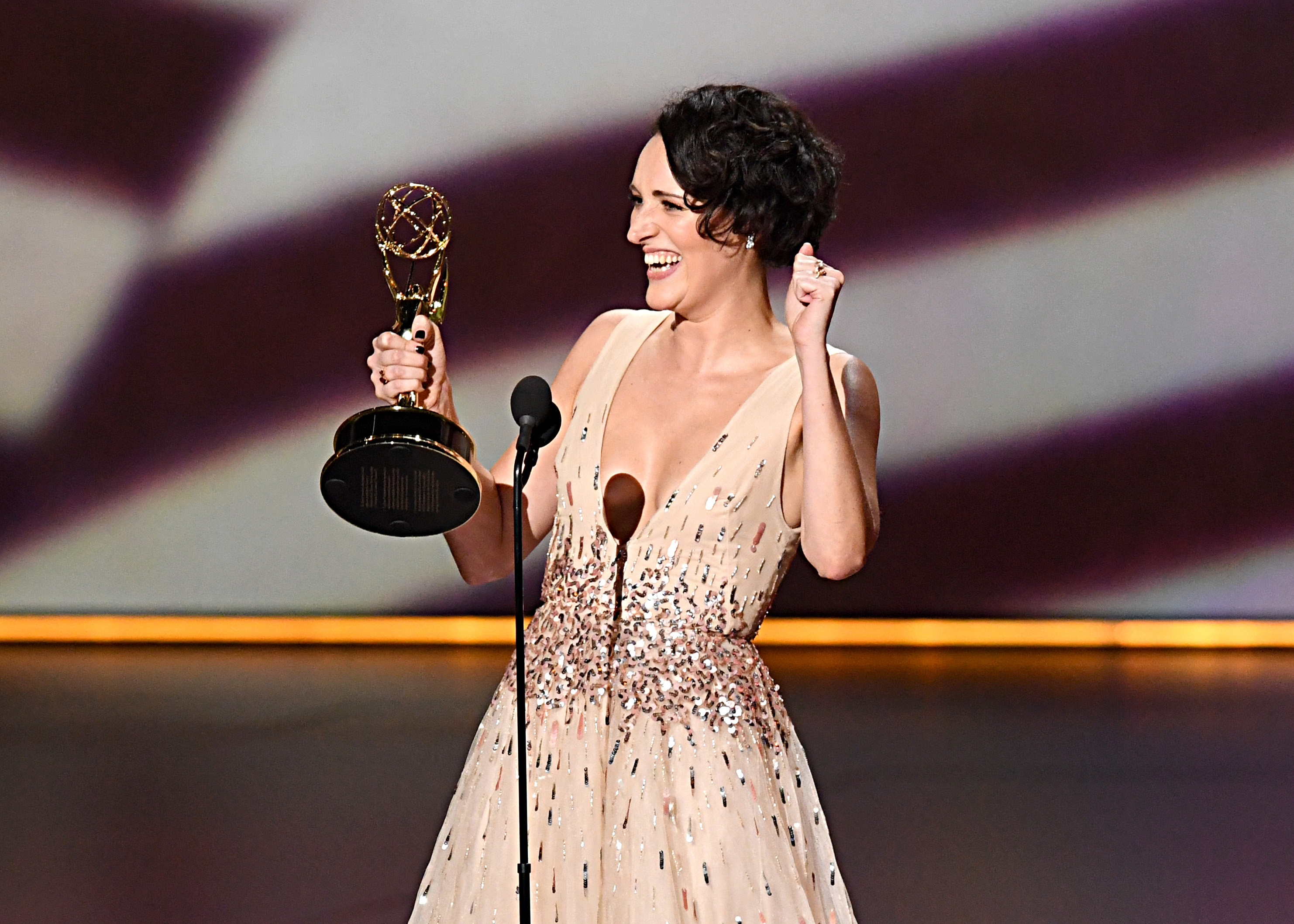 "LOS ANGELES, CALIFORNIA - SEPTEMBER 22: Phoebe Waller-Bridge accepts the Outstanding Writing for a Comedy Series award for ""Fleabag"" onstage during the 71st Emmy Awards at Microsoft Theater on September 22, 2019 in Los Angeles, California. (Photo by Jeff Kravitz/FilmMagic)"
