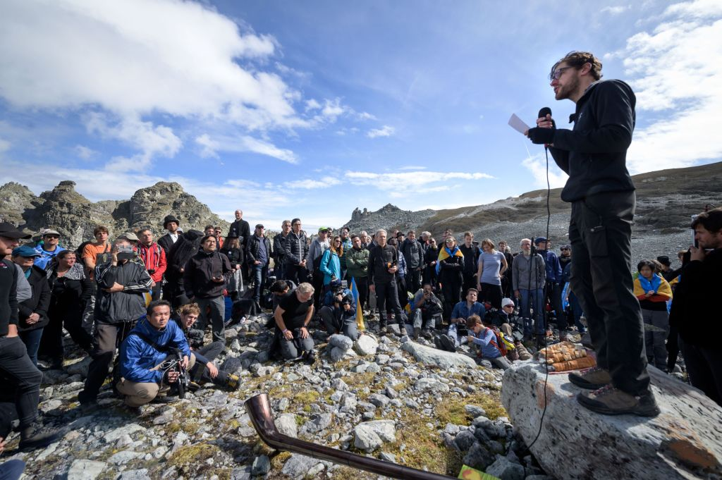 People take part in a ceremony to mark the 'death' of the Pizol glacier (Pizolgletscher) on Sept. 22, 2019 above Mels, eastern Switzerland.