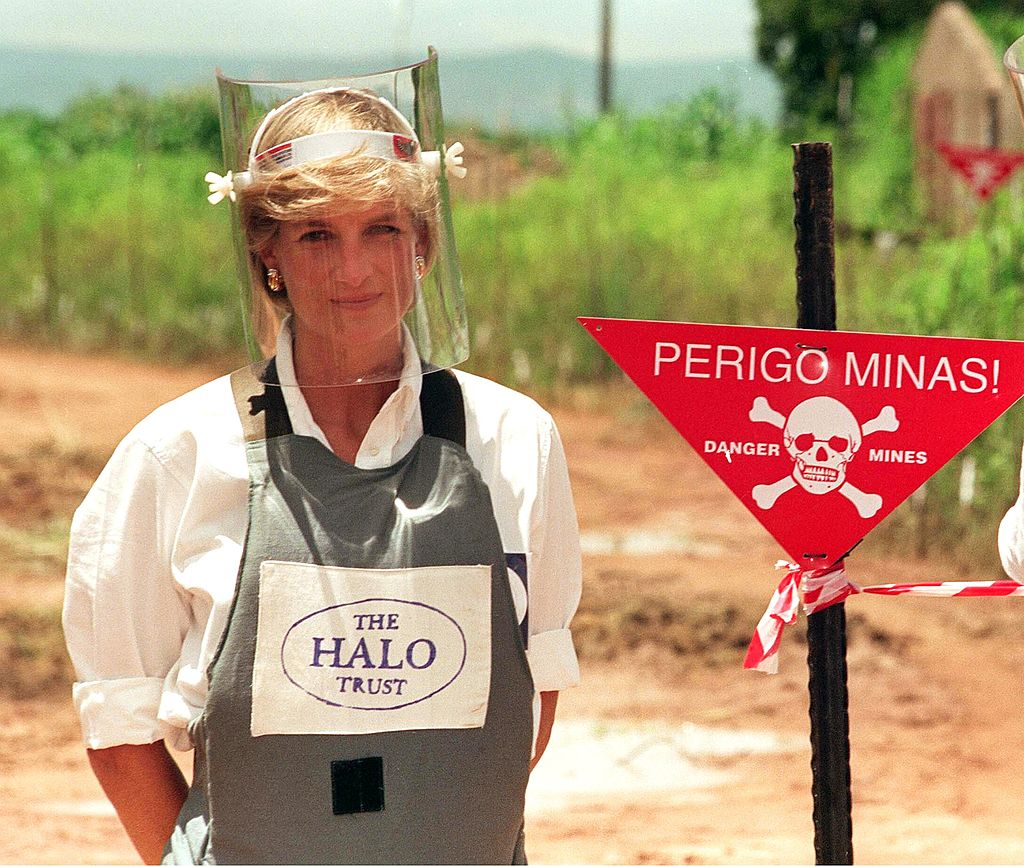 Diana, Princess of Wales, wears body armor during a visit to a landmine in January 1997 in Angola.