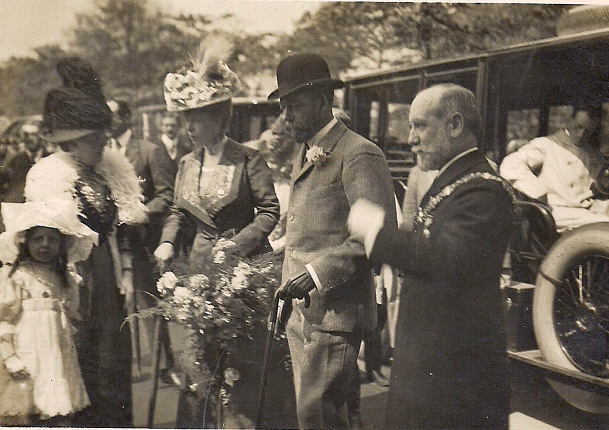 Queen Mary and King George V (both in the center) are flanked by the Mayor of Rotherham Alderman P Bancroft Coward (far right) and his wife during their July 8-12, 1912, visit.