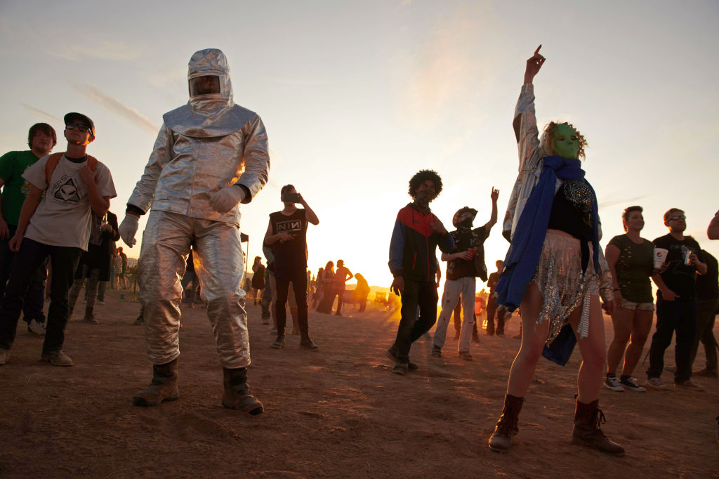 Attendees dance to music during Alienstock festival on the  Extraterrestrial Highway in Rachel, Nevada on September 20, 2019.