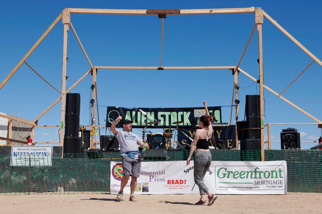 Attendees dance as a DJ plays music at Alienstock festival in Rachel, Nevada on September 20, 2019.