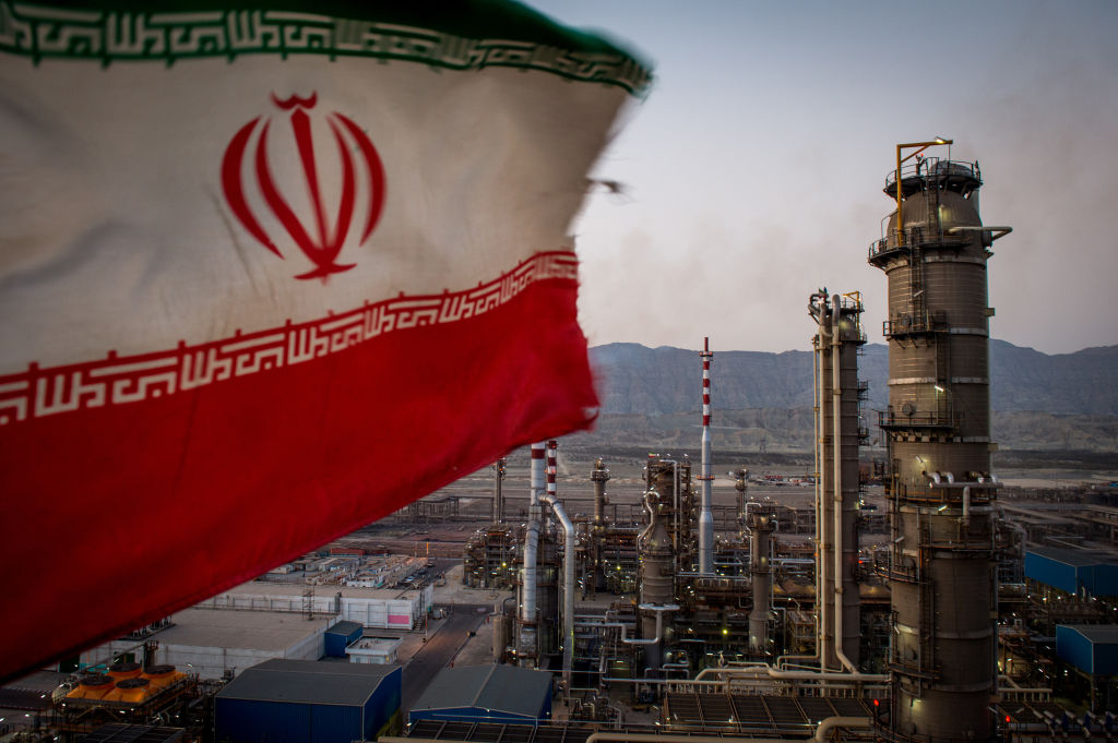 An Iranian national flag flies at the Persian Gulf Star Co. (PGSPC) gas condensate refinery in Bandar Abbas, Iran, on Jan. 9. 2019.