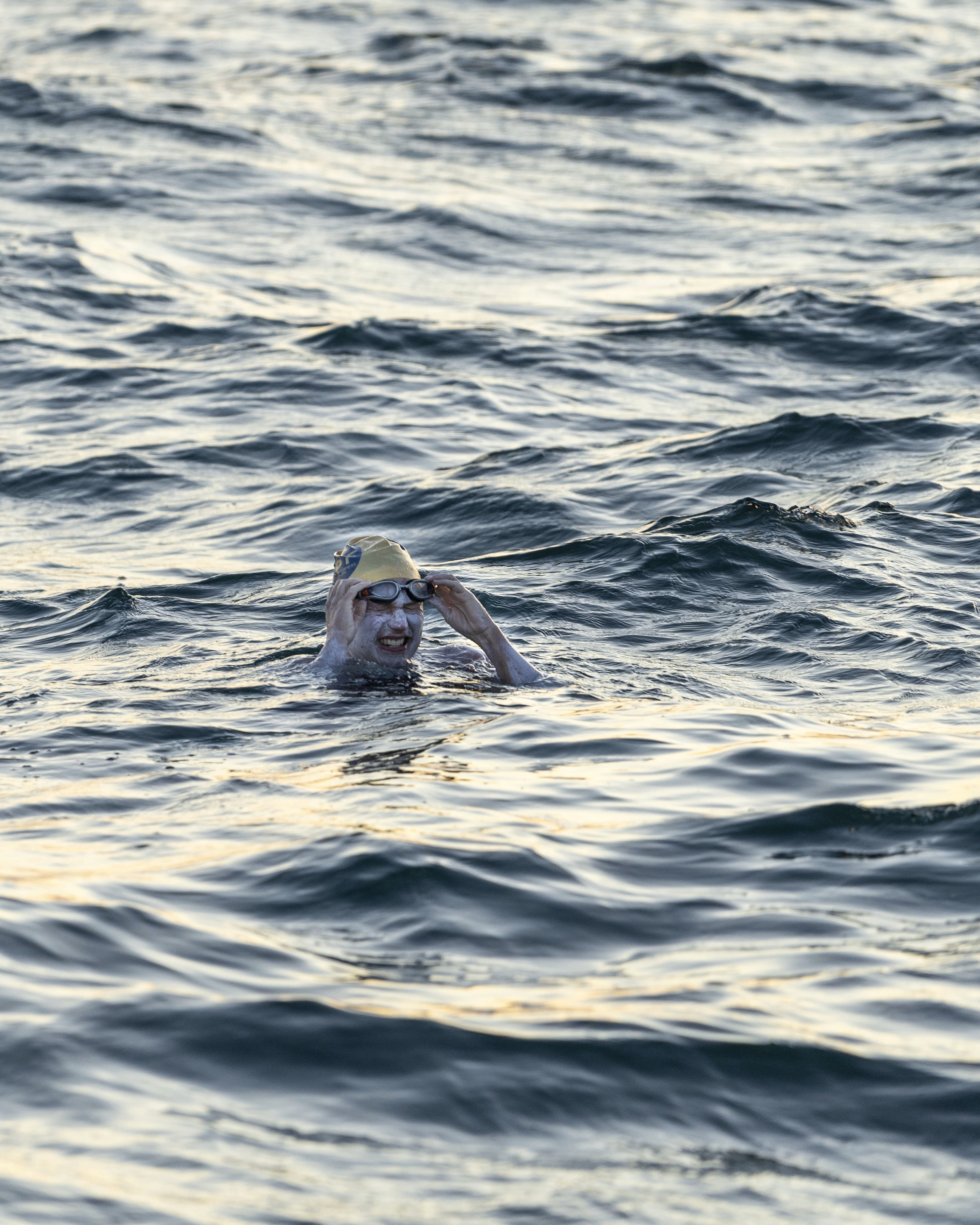 This undated photo shows American swimmer Sarah Thomas, 37, swims the English Channel. The American cancer survivor has become the first person to swim across the English Channel four times in a row completing the remarkable feat Tuesday morning Sept. 17, 2019, after more than 54 hours of swimming.