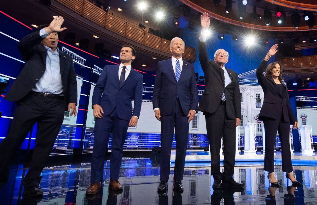 Entrepreneur Andrew Yang, Mayor of South Bend, Ind., Pete Buttigieg, Former Vice President Joe Biden, Vermont Sen. Bernie Sanders and California Sen. Kamala Harris arrive on stage for the second night of the first Democratic primary debate on June 27, 2019.