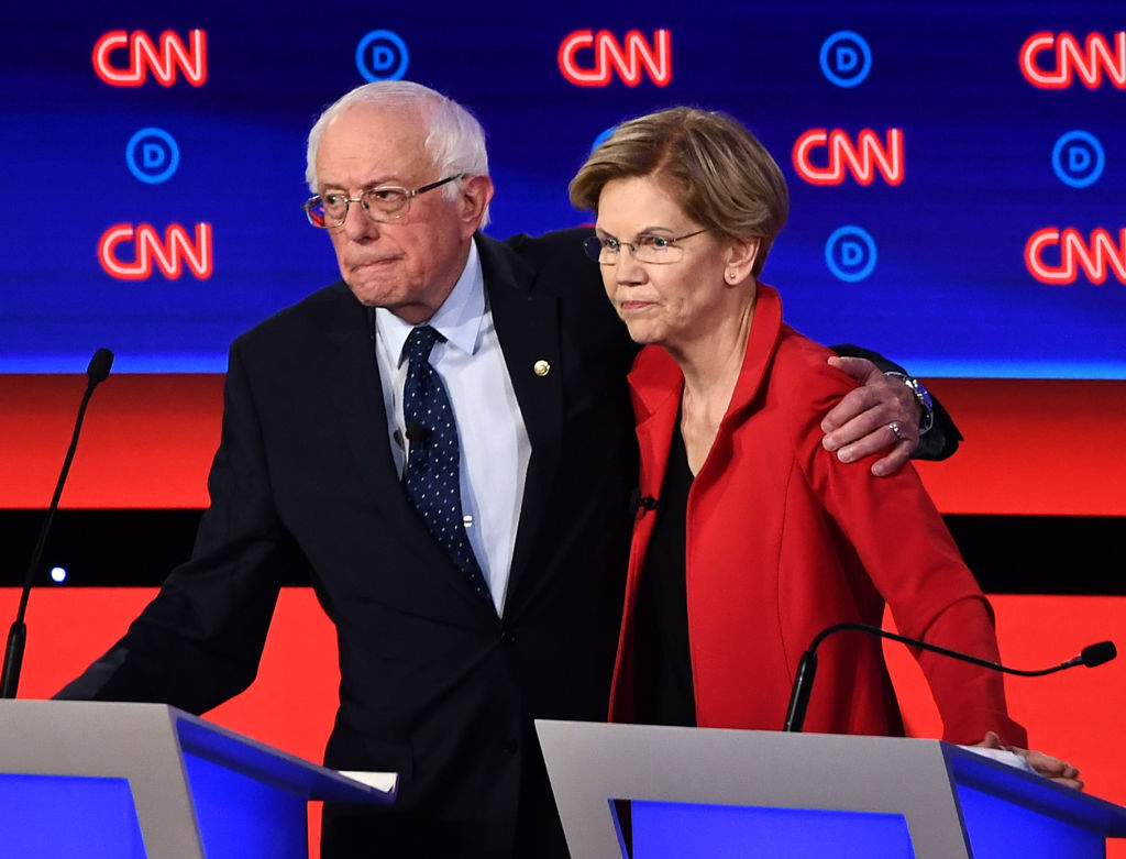 Vermont Sen. Bernie Sanders and Massachusetts Sen. Elizabeth Warren hug after participating in the first round of the second Democratic primary debate, on July 30, 2019.
