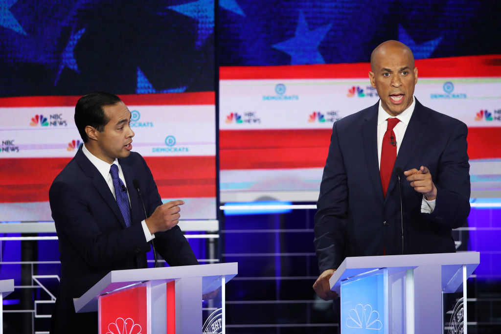 Former housing secretary Julian Castro and New Jersey Sen. Cory Booker during the first night of the Democratic presidential debate on June 26, 2019.