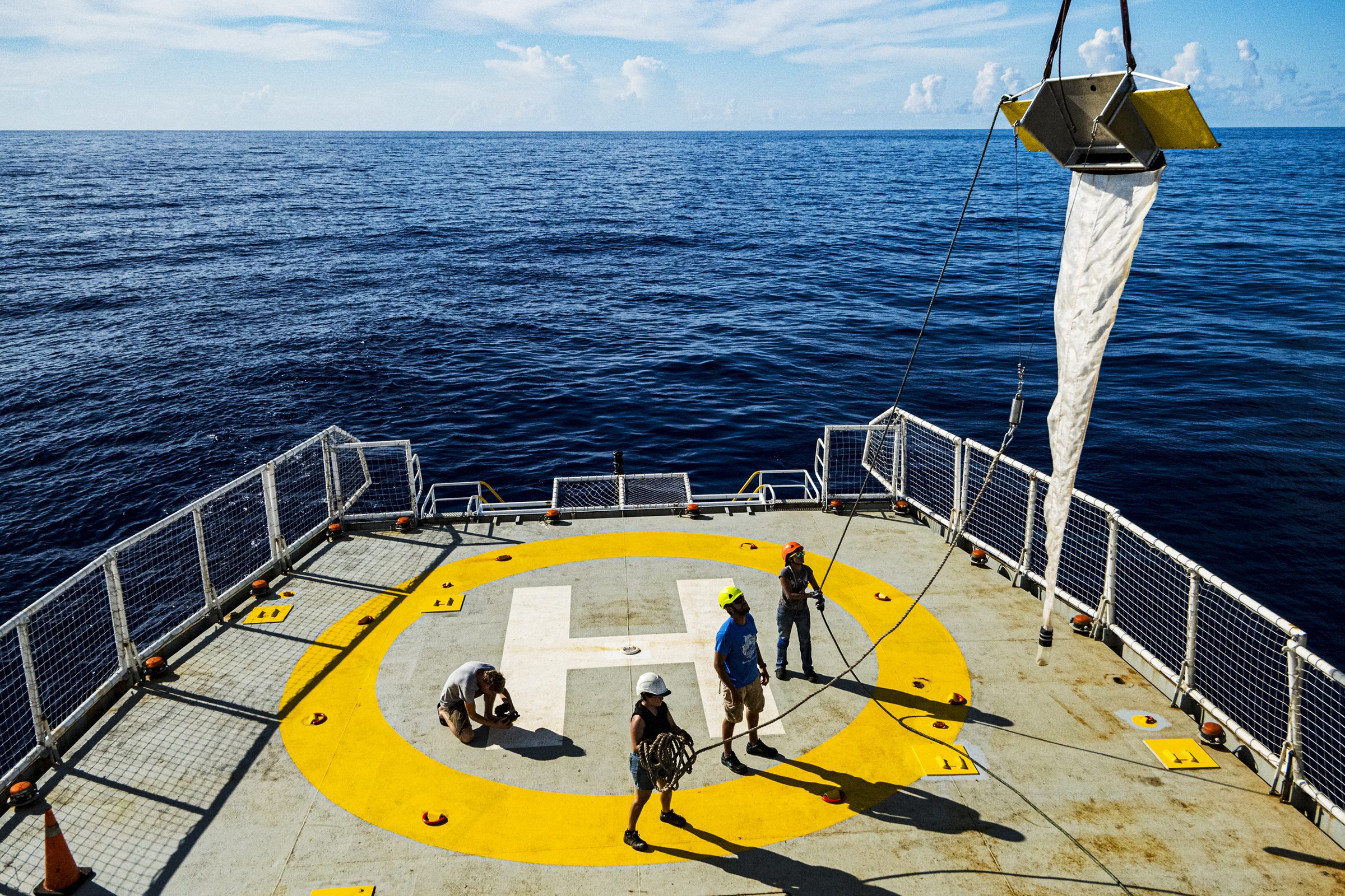 Crew members deploy a research trawl net from the deck of the MY Esperanza during the ship's expedition to the Sargasso Sea, a unique region in the North Atlantic Ocean that is home to a diverse array of marine life.