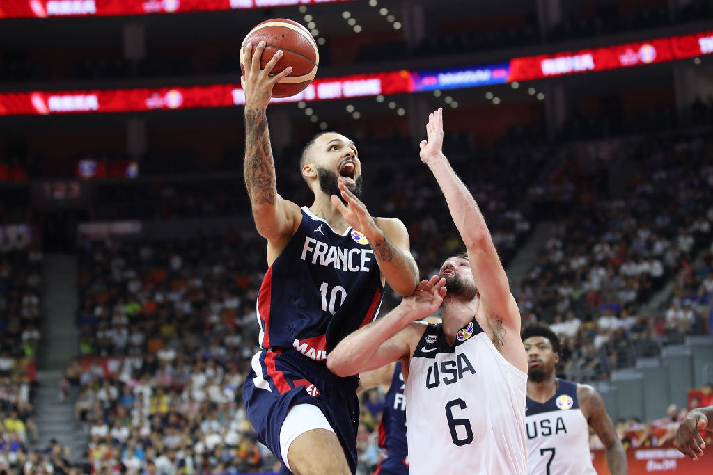 Evan Fournier #10 of France in action against Joe Harris of USA during FIBA World Cup 2019 Quarter-finals match between USA and France at Dongguan Basketball Center on September 11, 2019 in Dongguan, China.