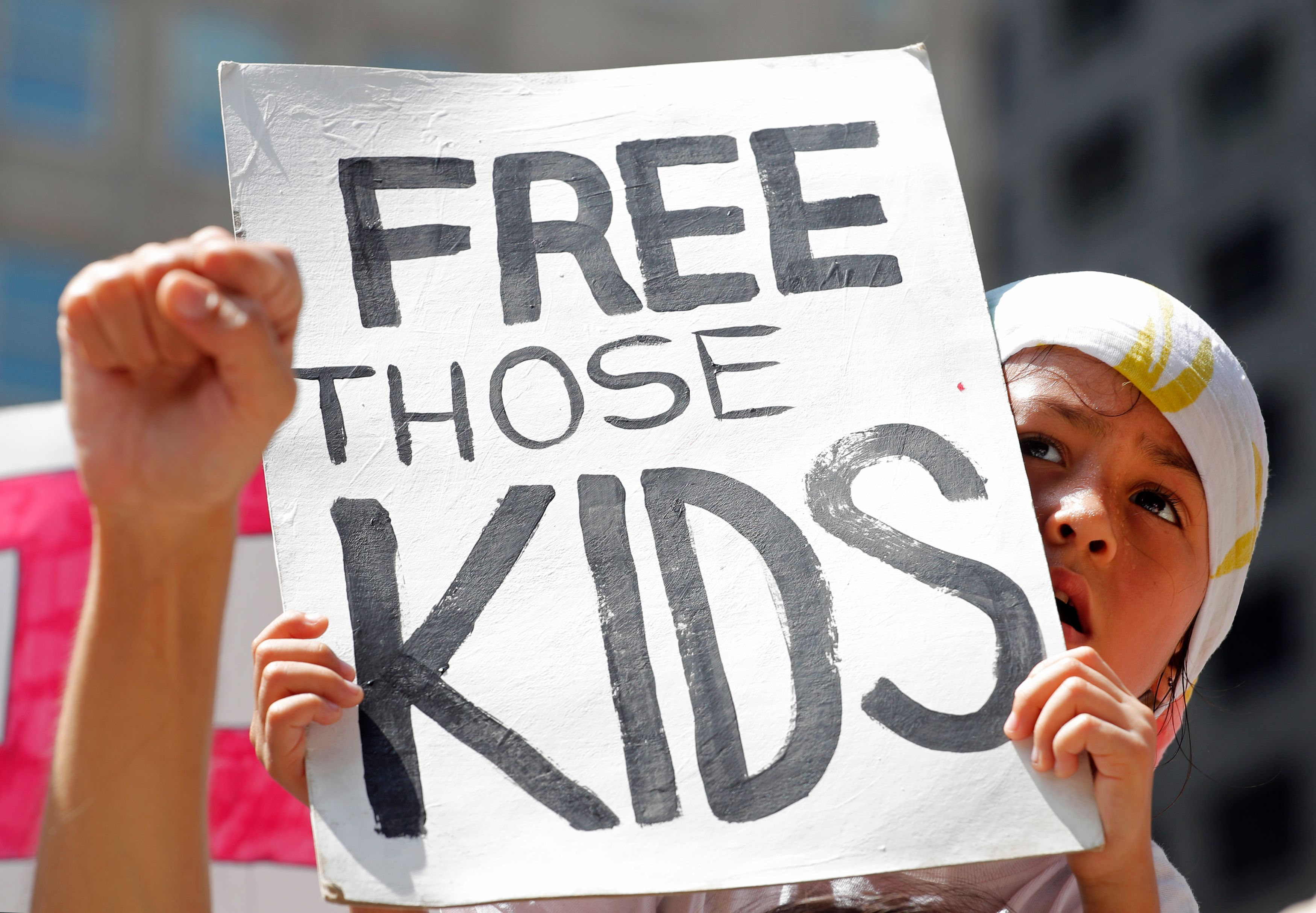 A girl takes part in a protest against the US immigration policies separating migrant families in Chicago, June 30, 2018. -