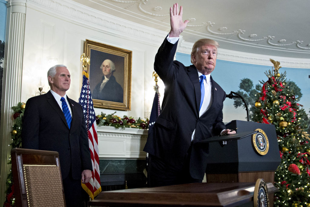 U.S. President Donald Trump waves next to U.S. Vice President Mike Pence, left, after making a statement on Jerusalem in the Diplomatic Room of the White House in Washington, D.C., U.S., on Wednesday, Dec. 6, 2017.