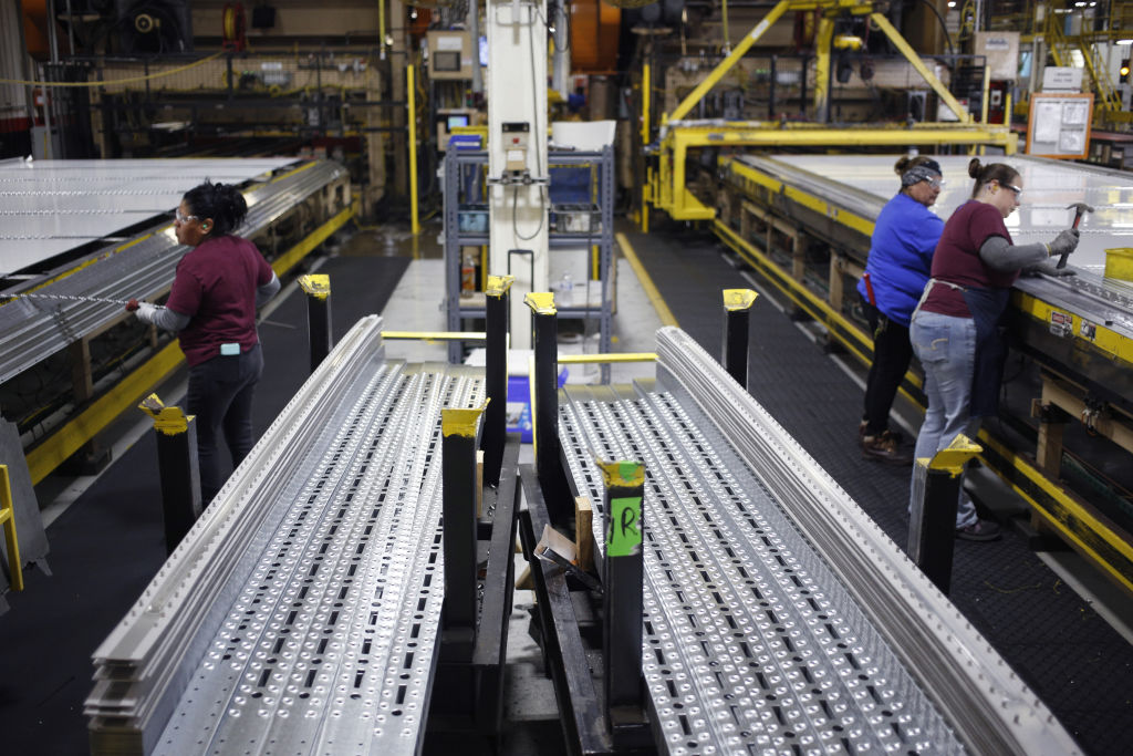 Aluminum semi-trailer components sit stacked at the Wabash National Corp. manufacturing facility in Lafayette, Indiana, U.S., on Tuesday, Aug. 13, 2019. American manufacturing unexpectedly contracted in August.
