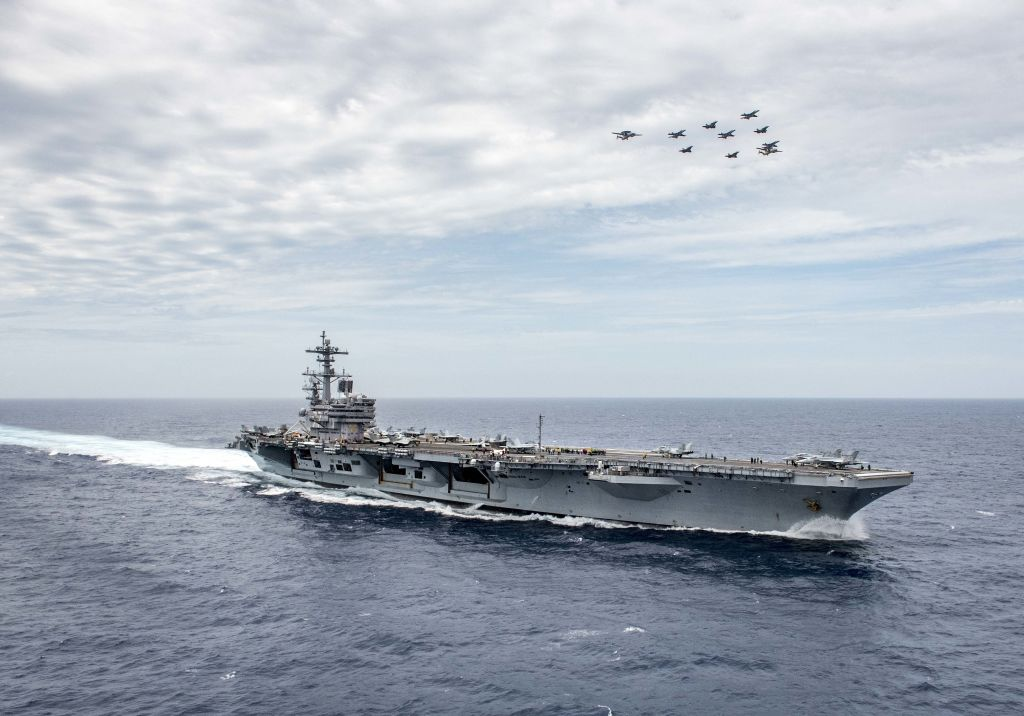 An aircraft flies in formation over the aircraft carrier USS George H.W. Bush during a joint training exercise involving US and French naval forces on May 15, 2018.
