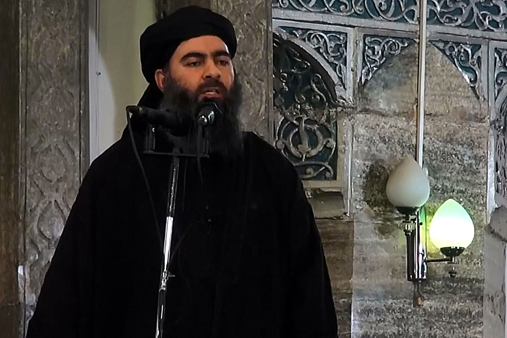An image grab taken from a video by Al-Furqan Media shows alleged Islamic State of Iraq and the Levant (ISIL) leader Abu Bakr al-Baghdadi preaching during Friday prayer at a mosque in Mosul, released on July 5, 2014.