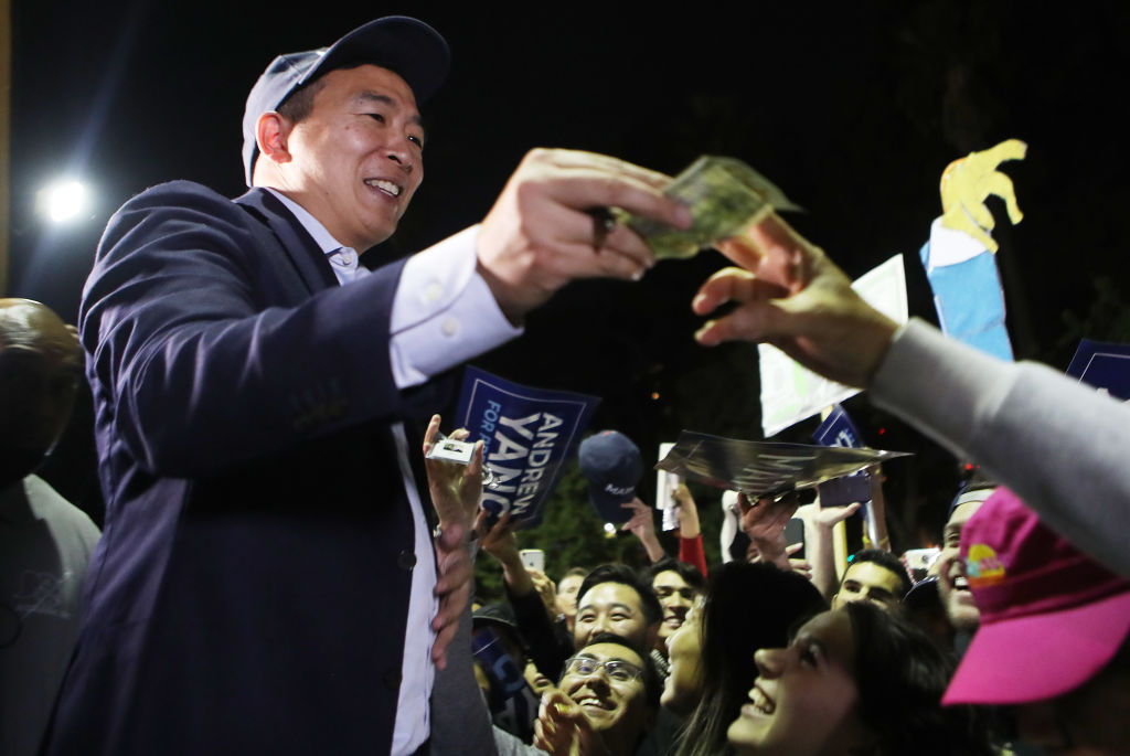 Democratic presidential candidate, entrepreneur Andrew Yang (L) greets supporters and autographs items at a campaign rally on September 30, 2019 in Los Angeles, California.