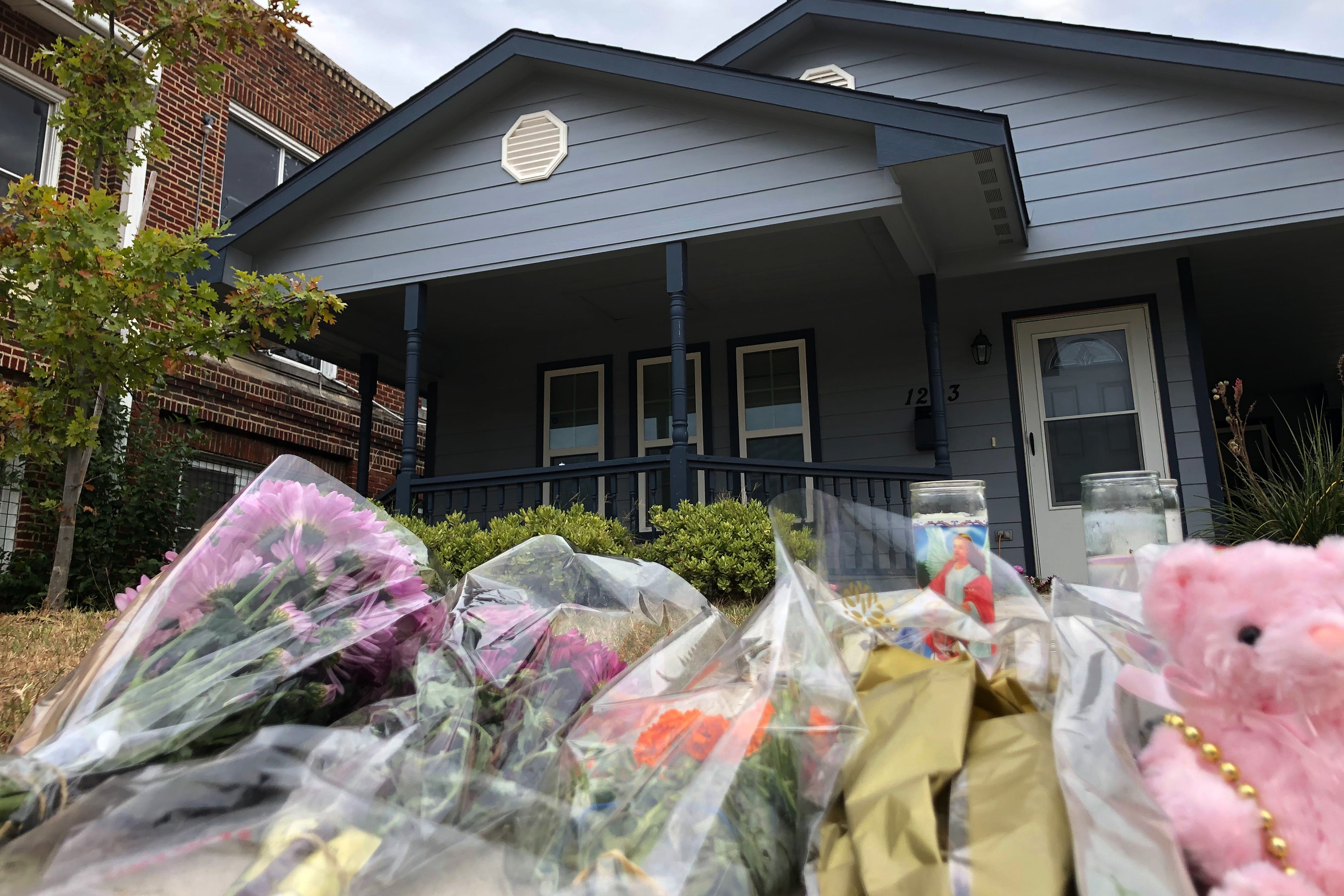 Bouquets of flowers and stuffed animals are piling up outside the Fort Worth home Monday, Oct. 14, 2019, where a 28-year-old black woman was shot to death by a white police officer. Members of the community have brought tributes to the home where Atatiana Jefferson was killed early Saturday by an officer who was responding to a neighbor's report of an open door.