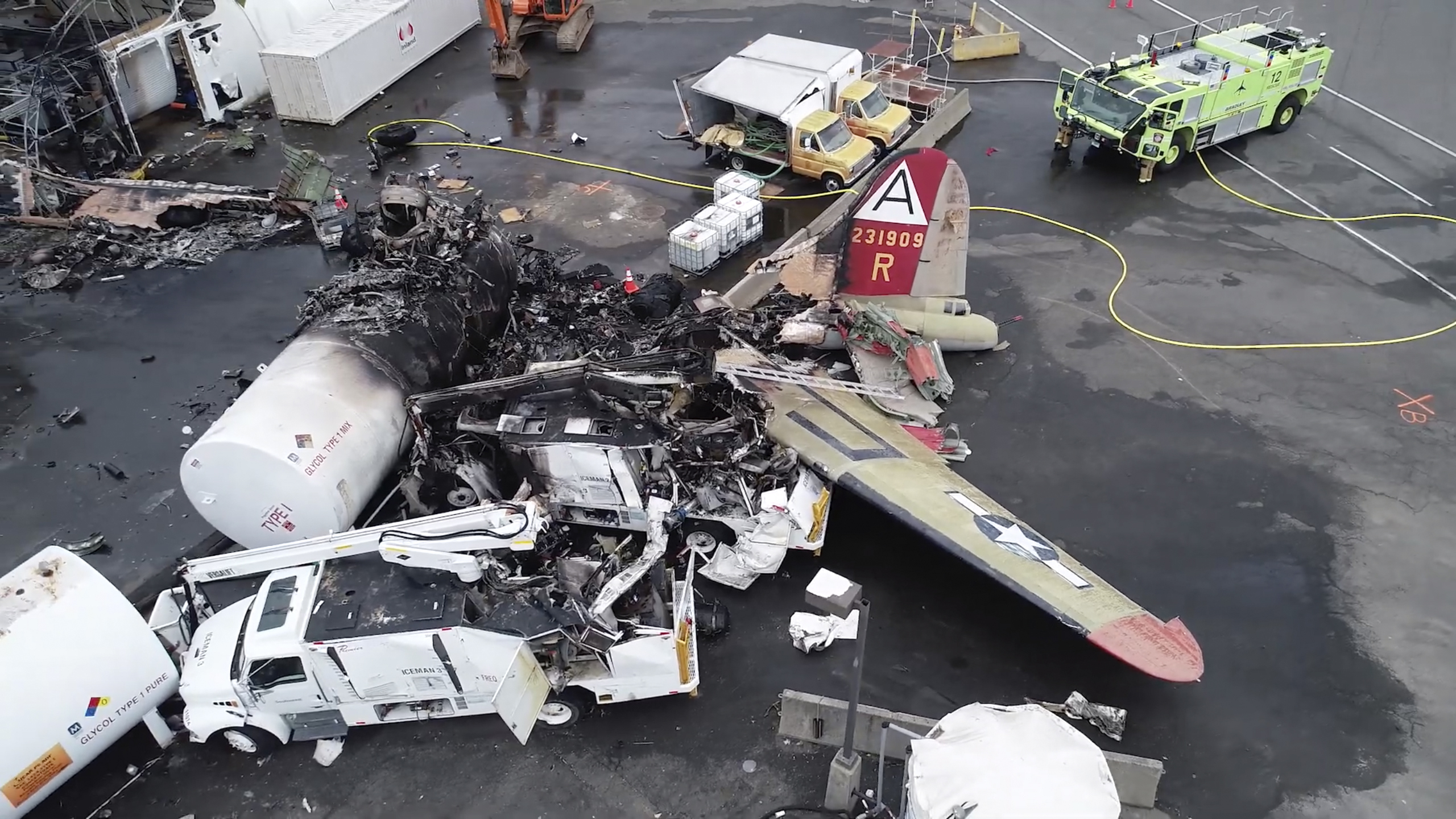 This image taken from video provided by National Transportation Safety Board shows damage from a World War II-era B-17 bomber plane that crashed Wednesday at Bradley International Airport, Thursday, Oct. 3, 2019 in Windsor Locks, Conn.