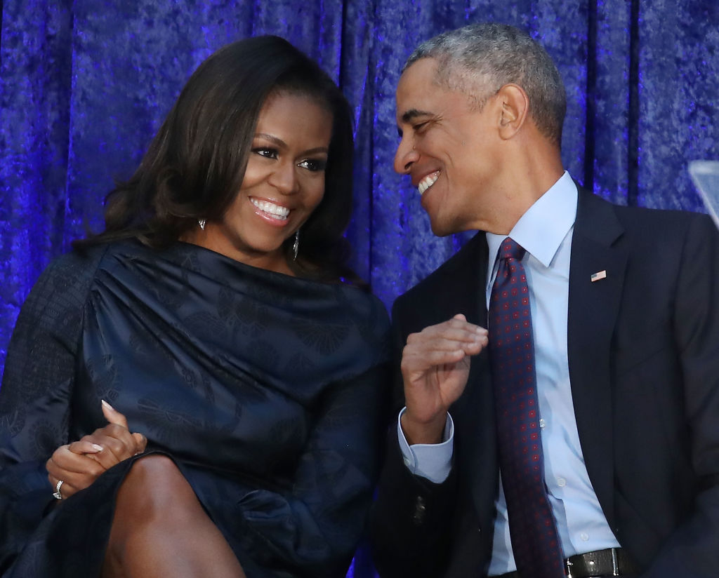 Former U.S. President Barack Obama and first lady Michelle Obama participate in the unveiling of their official portraits during a ceremony at the Smithsonian's National Portrait Gallery, on February 12, 2018 in Washington, D.C.