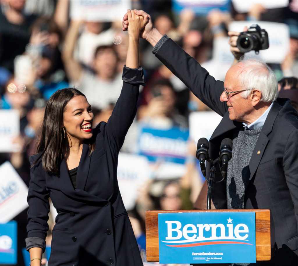U.S. Representative Alexandria Ocasio-Cortez & U.S. Senator Bernie Sanders on stage at Bernie Sanders Rally  Bernie's Back  in Queensbridge Park on Oct. 19, 2019.