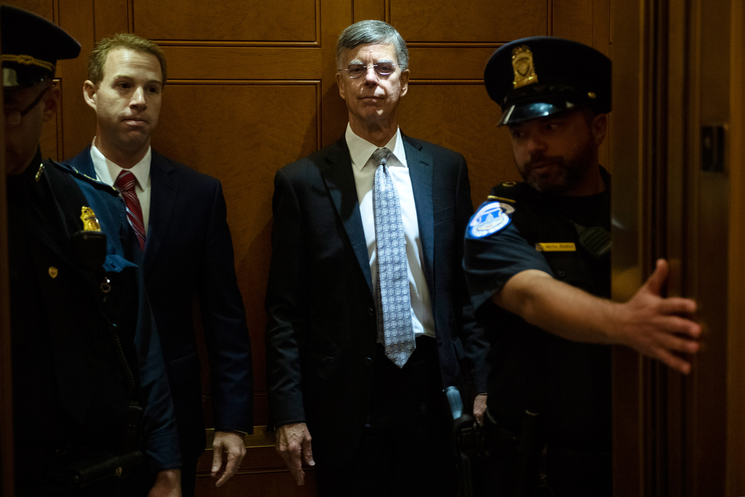 Bill Taylor, center, the acting U.S. ambassador to Ukraine, arrives at the Capitol for a deposition related to the House's impeachment inquiry on Oct. 22, 2019.