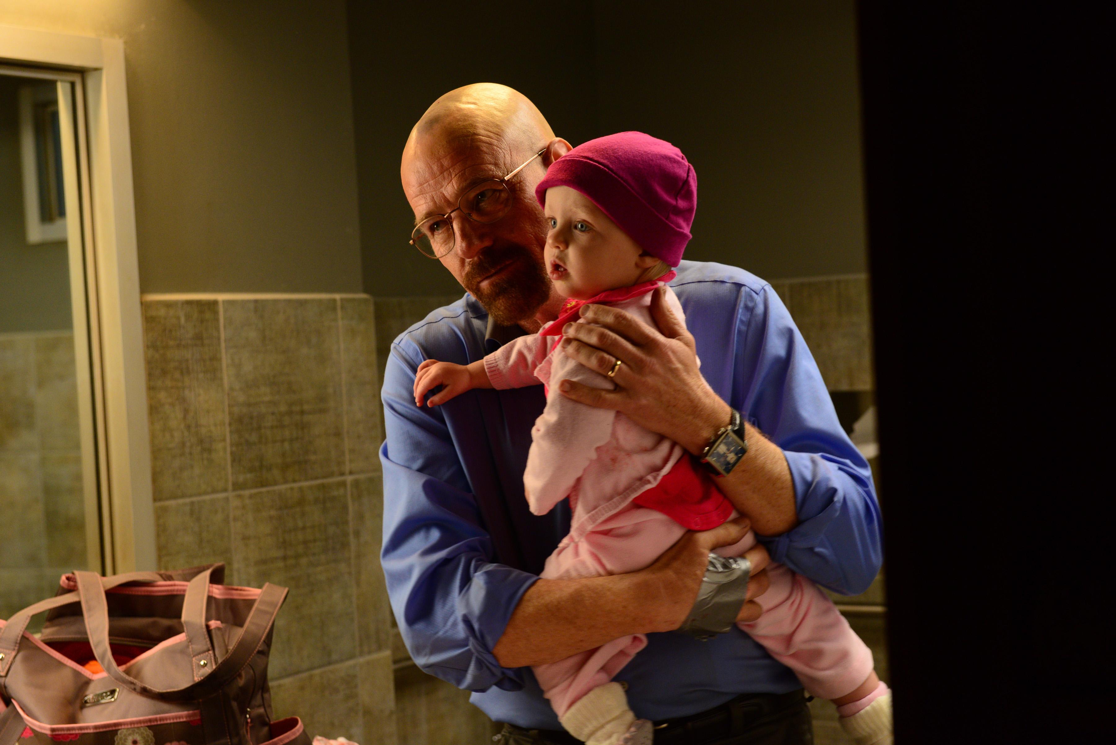 Bryan Cranston as Walter White and Moira Bryg MacDonald as Holly White in Breaking Bad Season 5, Episode 14
