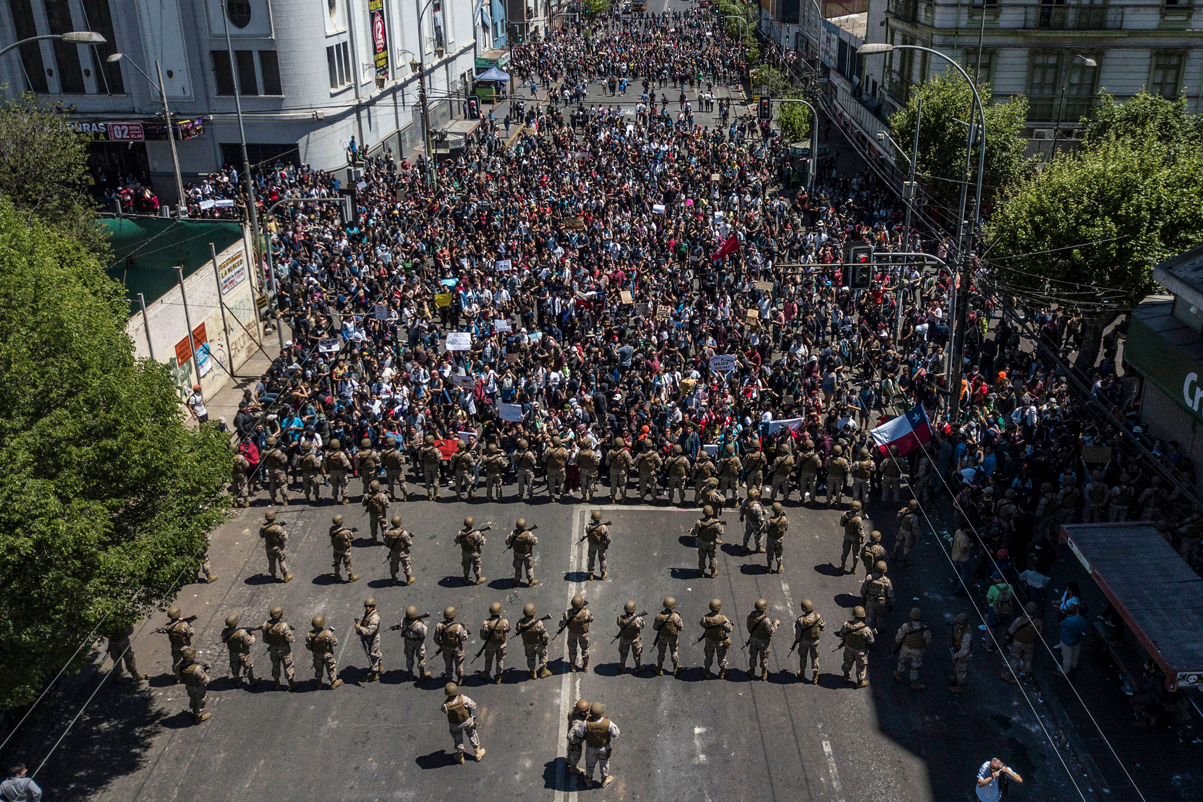Aerial view of demonstrators during the fifth straight day of protests against a now suspended hike in metro ticket prices in Valparaiso Chile, on Oct. 22, 2019.