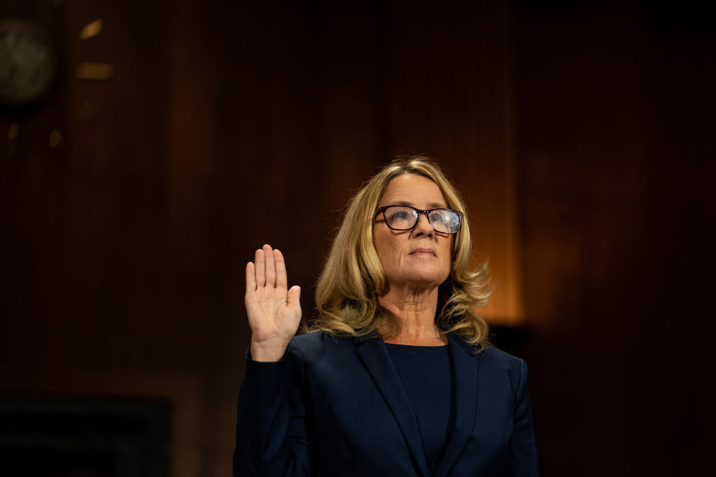 Christine Blasey Ford is sworn in prior to giving testimony before the U.S. Senate Judiciary Committee on Capitol Hill on Sept. 27, 2018 in Washington, DC. Blasey Ford had accused now Supreme Court Justice Brett Kavanaugh of sexually assaulting her during a party in 1982 when they were high school students in suburban Maryland.