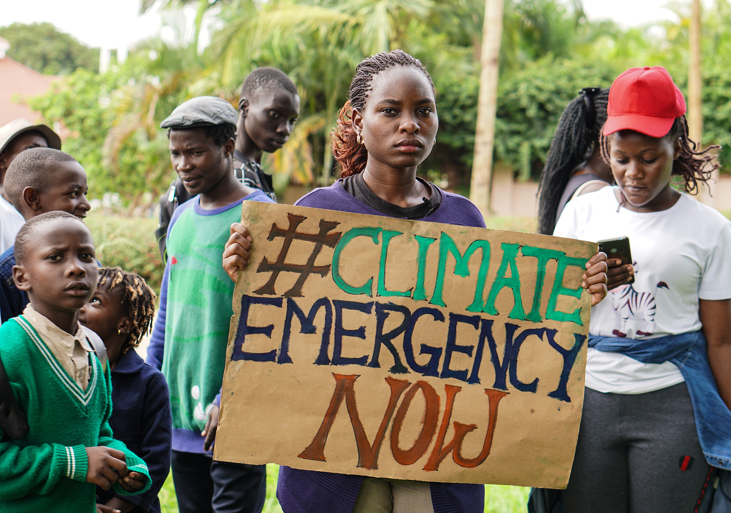 'Fridays for Future' coordinator Hilda Flavia Nakabuye holds a sign during the global 'School Strike for Climate' in Kampala, Uganda on May 24, 2019.