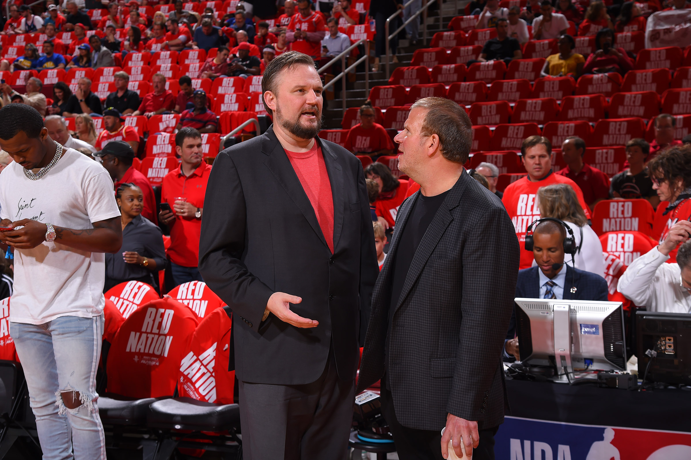 Houston Rockets General Manager Daryl Morey and Houston Rockets owner Tilman Fertitta speak during Game Four of the Western Conference Semifinals of the 2019 NBA Playoffs on May 6, 2019 in Houston.