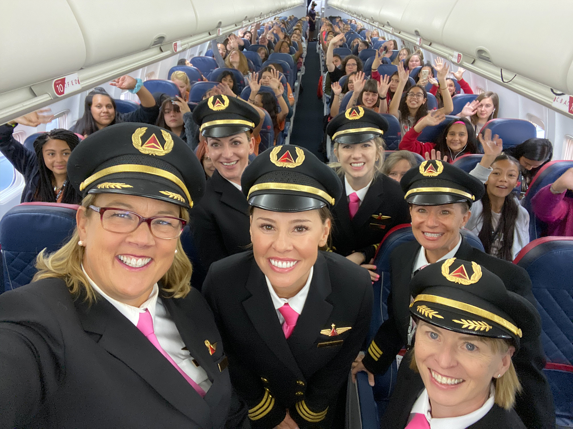 Female crew and passengers onboard a Delta flight headed to NASA in Houston in October 2019 as part of the company's initiative to close the gender gap in aviation.
