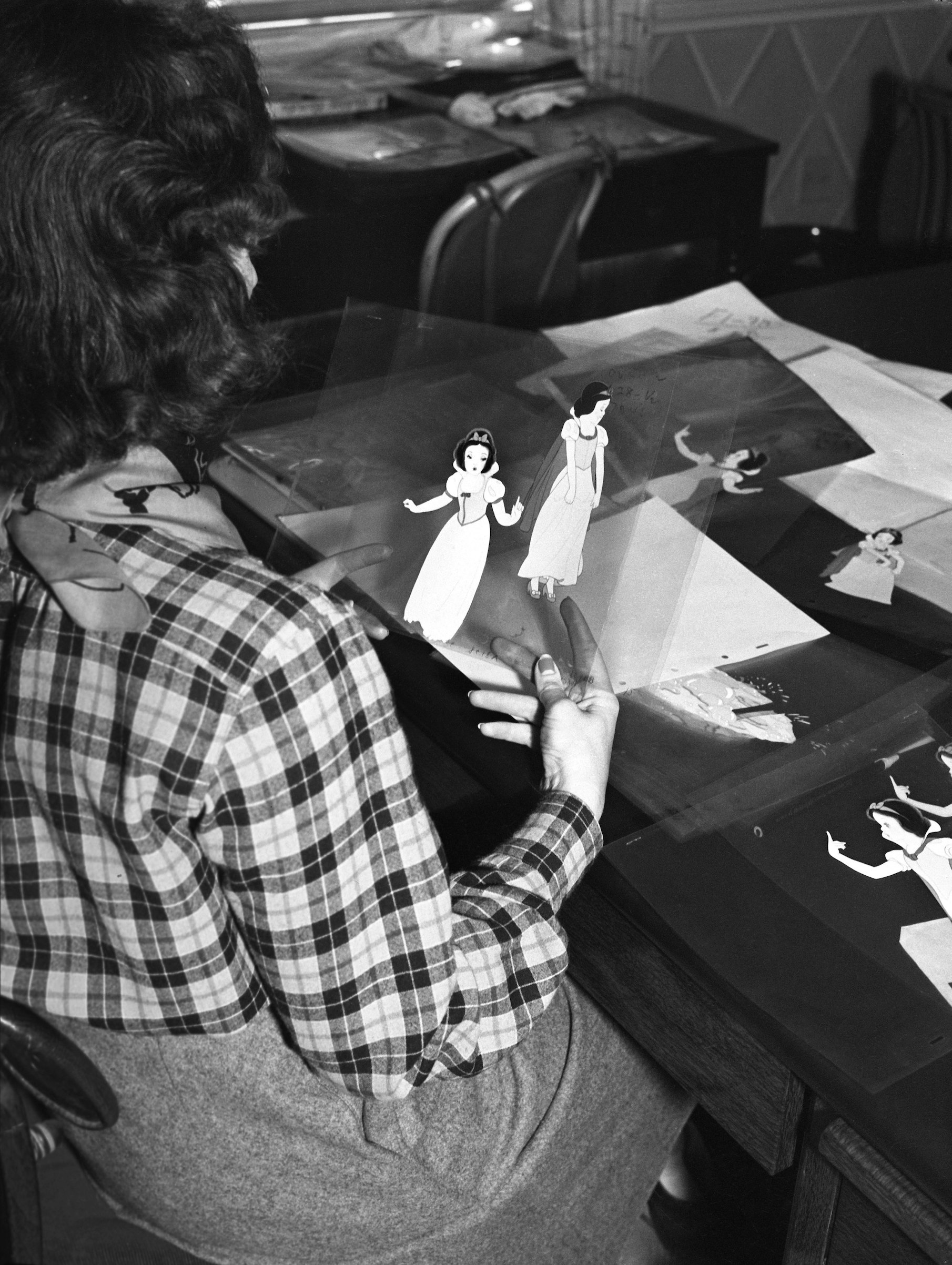 A Disney animator works on cells from the film 'Snow White' circa 1936 in Los Angeles, Calif.
