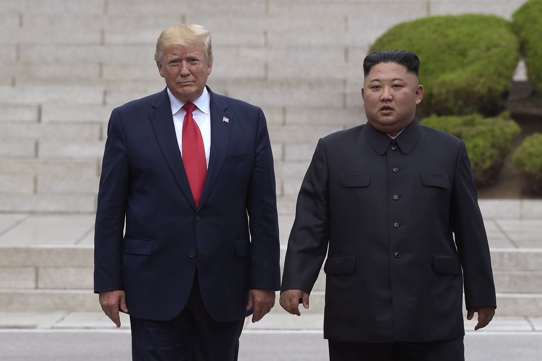U.S. President Donald Trump, left, meets with North Korean leader Kim Jong Un at the North Korean side of the border at the village of Panmunjom in Demilitarized Zone on June 30, 2019. A senior North Korean diplomat on Tuesday, Oct. 1, 2019, says North Korea and the United States have agreed to resume nuclear negotiations on Oct. 5 following a months-long stalemate over withdrawal of sanctions in exchange for disarmament. (AP Photo/Susan Walsh, File)