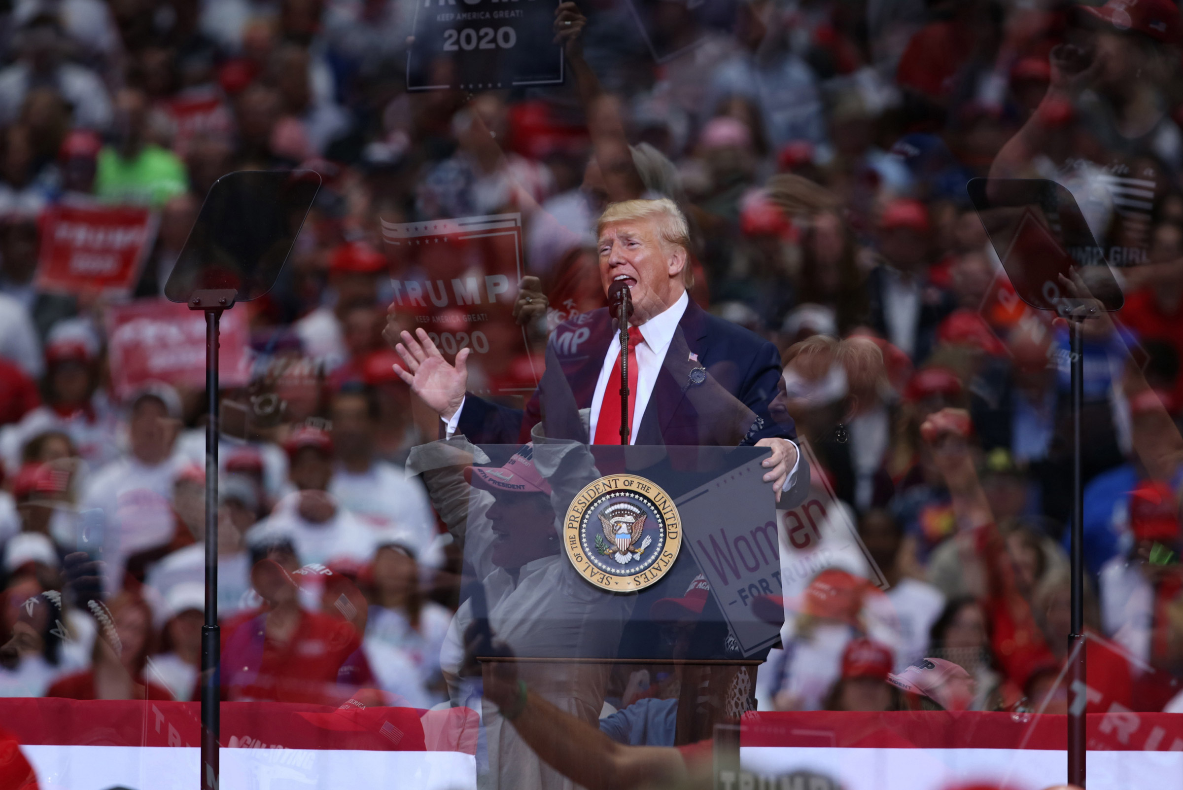 President Donald Trump is seen speaking in this double exposure photograph taken during a rally in Dallas, on Oct. 17, 2019.