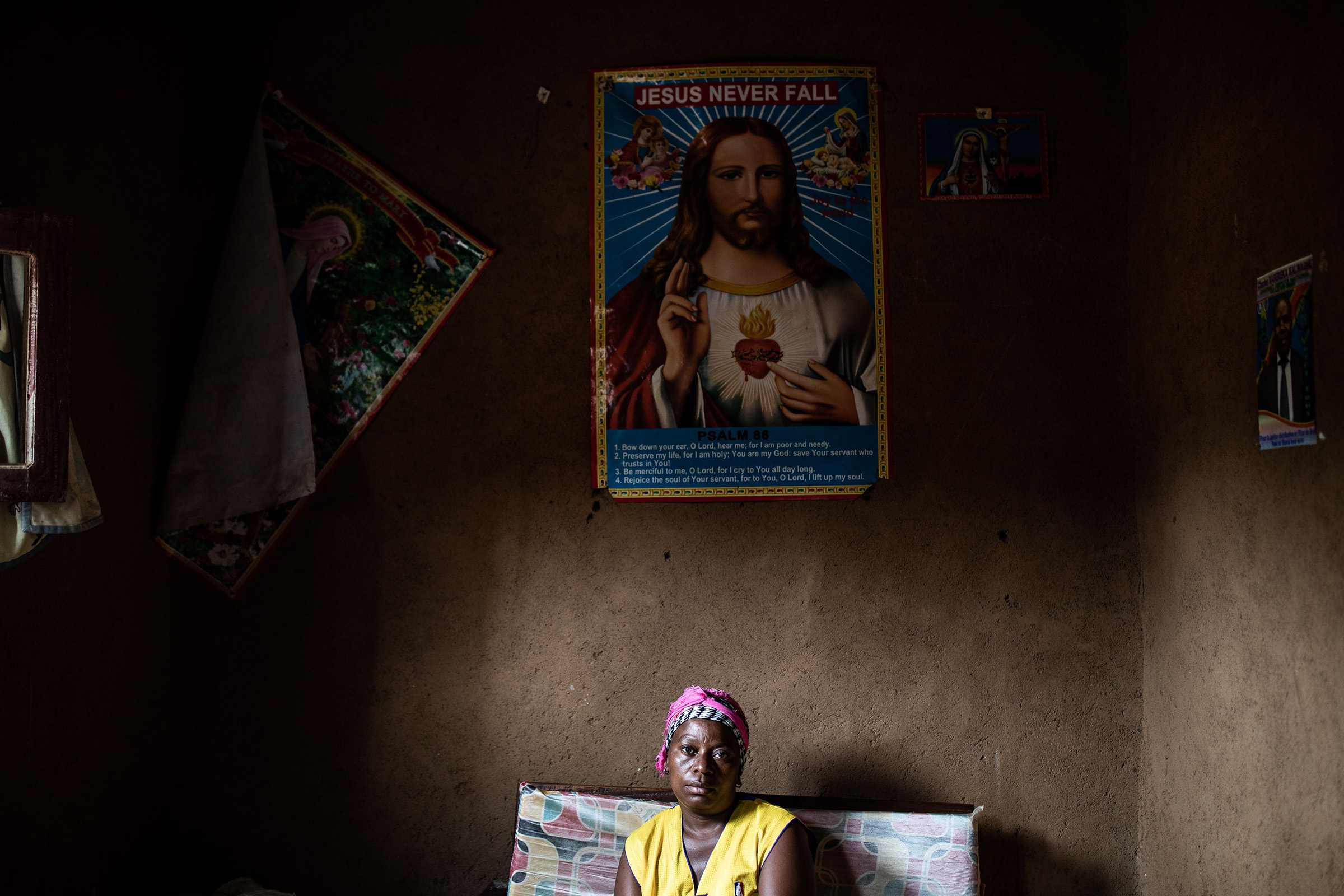Janine Kibwana, 32-years-old, an Ebola survivor and mother to five children sits inside her living room in Beni, north eastern Democratic Republic of the Congo on September 17, 2019.