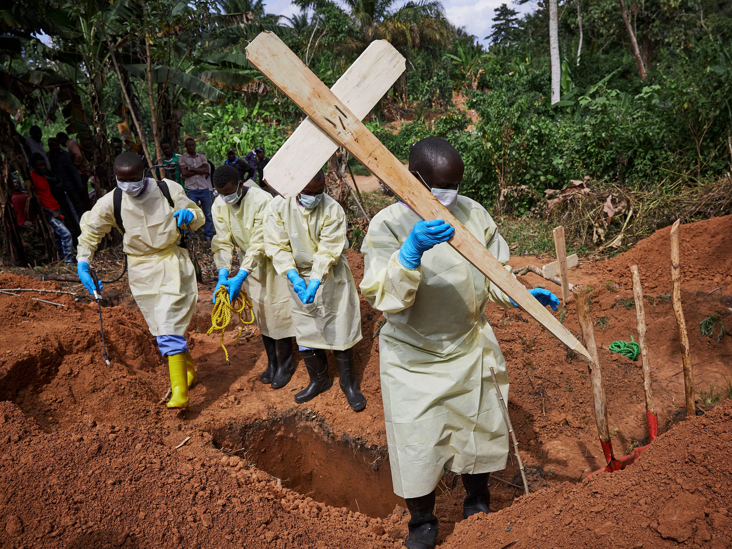 Health workers undertaking the burial of an eleven-month old child, Bunzi, in Beni, North Kivu province, Democratic Republic of the Congo, on May 5th 2019.