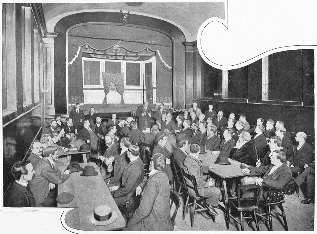 A discussion at the Eleusis Club, London, circa 1903 (1903). The Eleusis Club in Chelsea was a radical political club that promoted working class electoral registration. It evolved out of a branch of the Reform League.