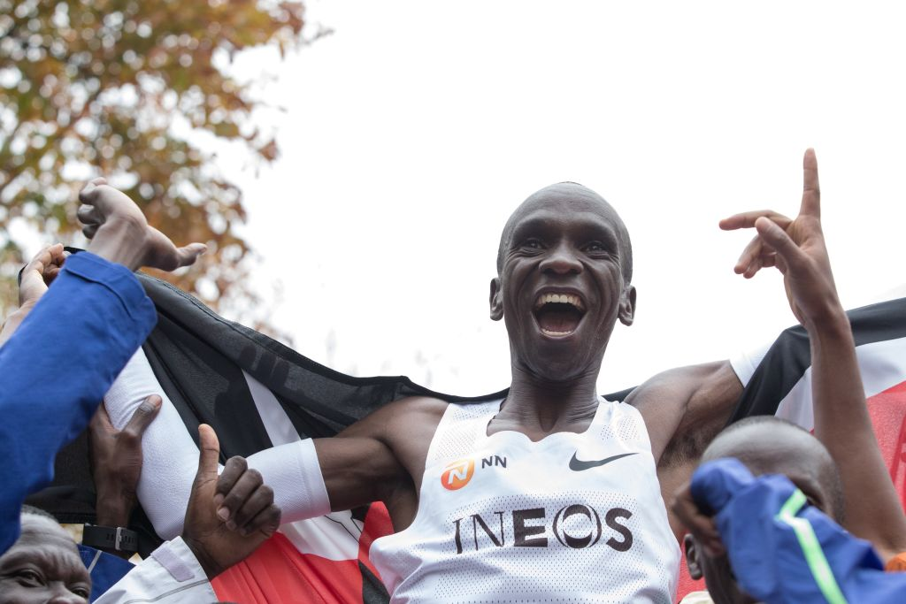 Eliud Kipchoge celebrates after crossing the finish line at the end of his attempt to bust the mythical two-hour barrier for the marathon on October 12 2019 in Vienna, Austria.