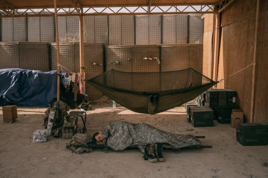 An American soldier sleeps at a military outpost in Ghazni, Afghanistan, in August 2018.