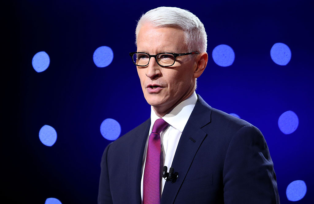 Debate moderator Anderson Cooper looks during the CNN Democratic Presidential Primary Debate between Democratic presidential candidate Hillary Clinton and candidate Senator Bernie Sanders at the Whiting Auditorium at the Cultural Center Campus on March 6, 2016 in Flint, Michigan.