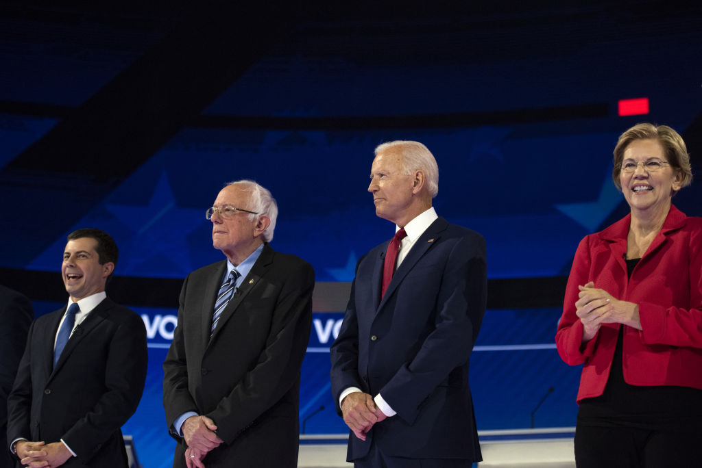 2020 presidential candidates Pete Buttigieg, mayor of South Bend, Ind., Senator Bernie Sanders of Vermont, former Vice President Joe Biden, and Senator Elizabeth Warren of Massachusetts stand on stage during the Democratic presidential candidate debate in Houston, Texas, U.S., on Thursday, Sept. 12, 2019.