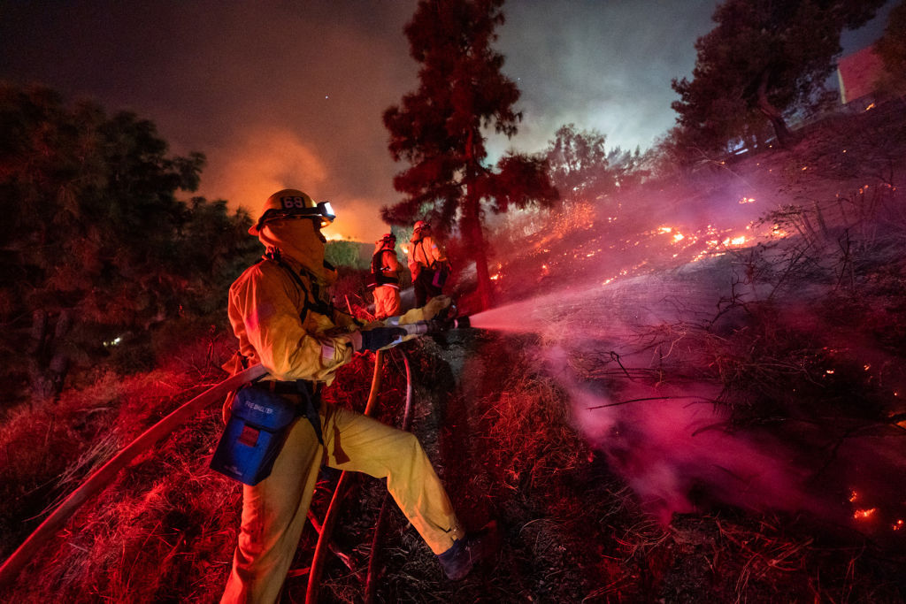 Firefighters work near Getty Center in Los Angeles Oct. 28, 2019. Thousands of residents were forced to evacuate their homes after a fast-moving wildfire erupted early Monday morning near the famous Getty Center.