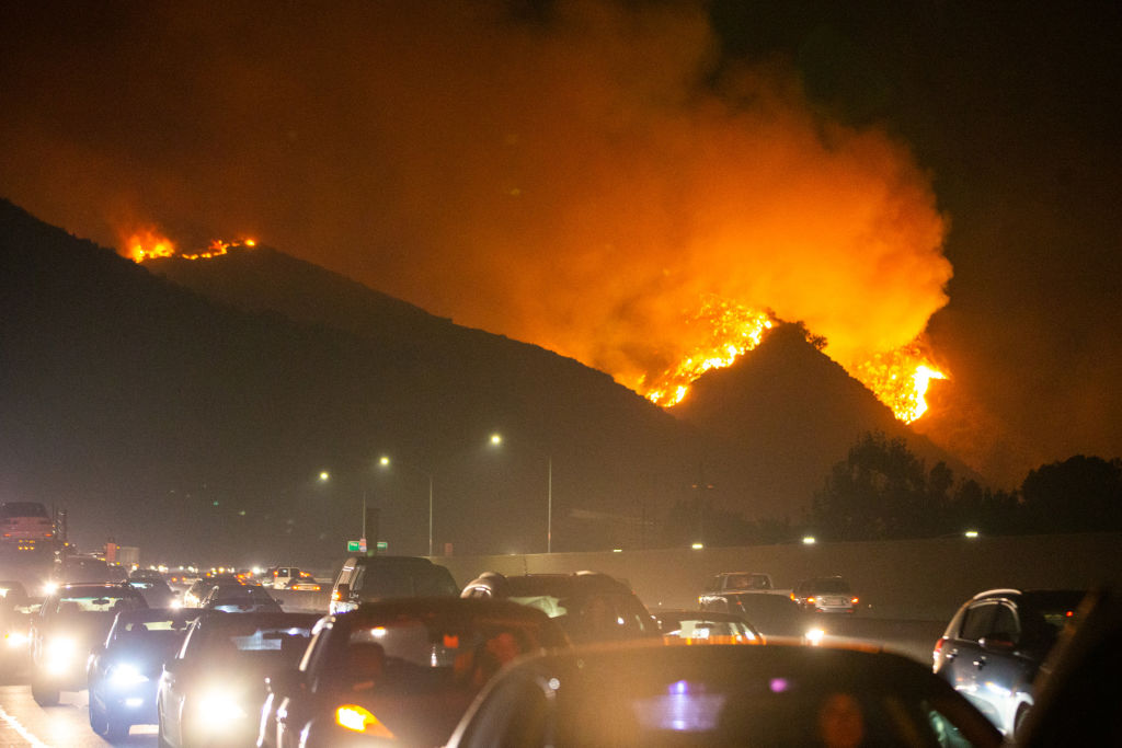 Fire is seen near Getty Center in Los Angeles, the United States, Oct. 28, 2019. Thousands of residents were forced to evacuate their homes after a fast-moving wildfire erupted early Monday morning near the famous Getty Center in Los Angeles in the western U.S. state of California.