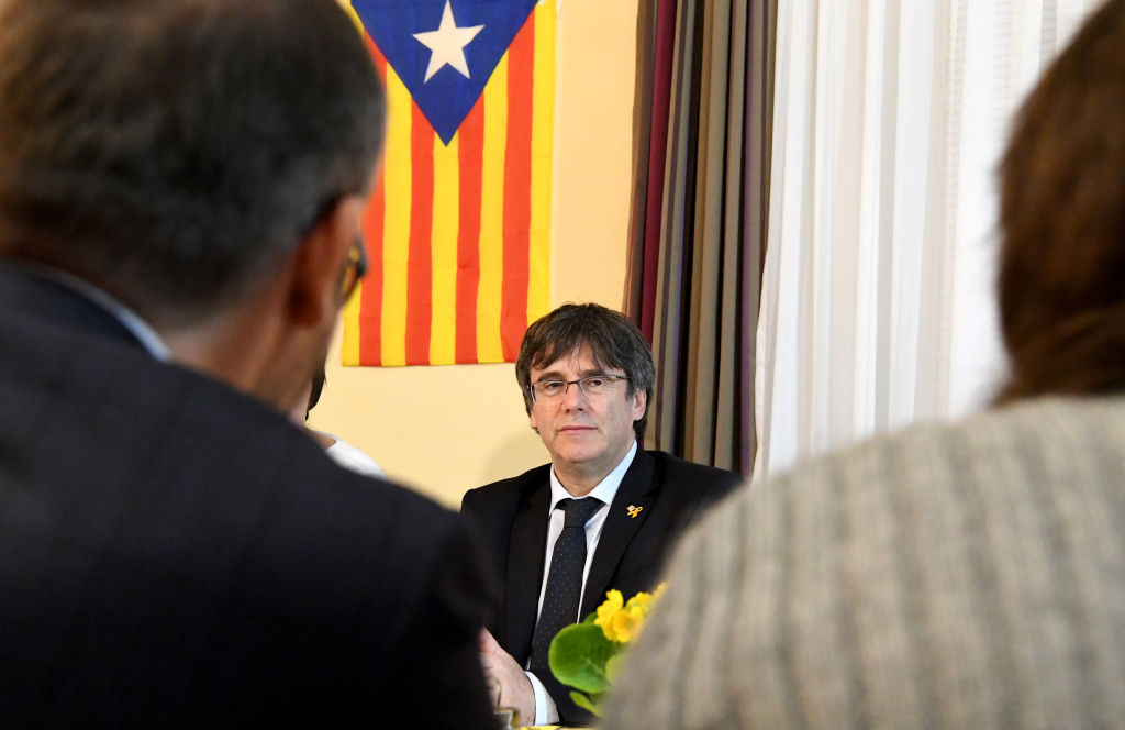 Catalan separatist leader Carles Puigdemont talks to supporters.