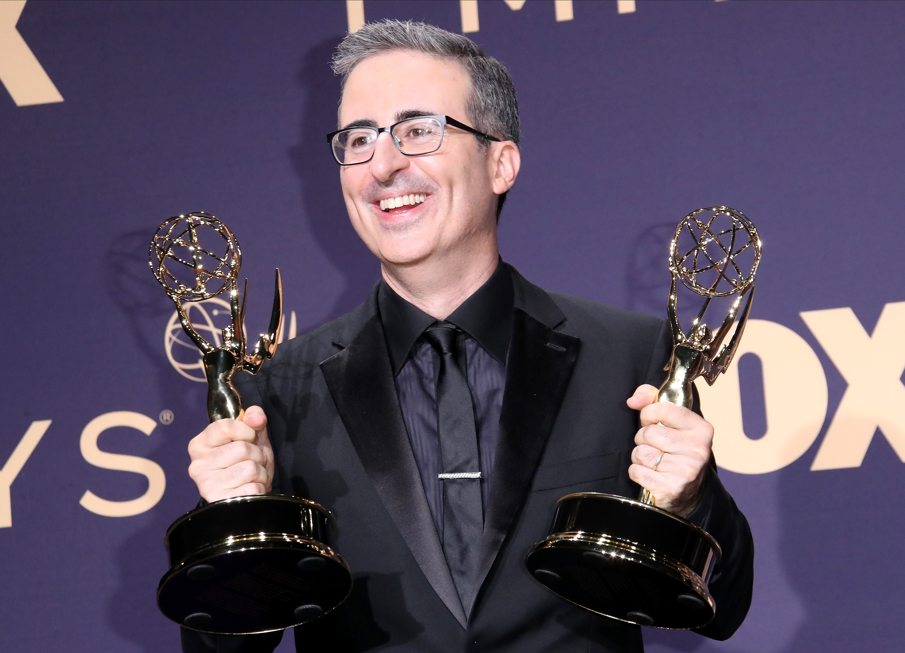 John Oliver poses with awards for Outstanding Variety Talk Series in the press room during the 71st Emmy Awards at Microsoft Theater on September 22, 2019 in Los Angeles, California.