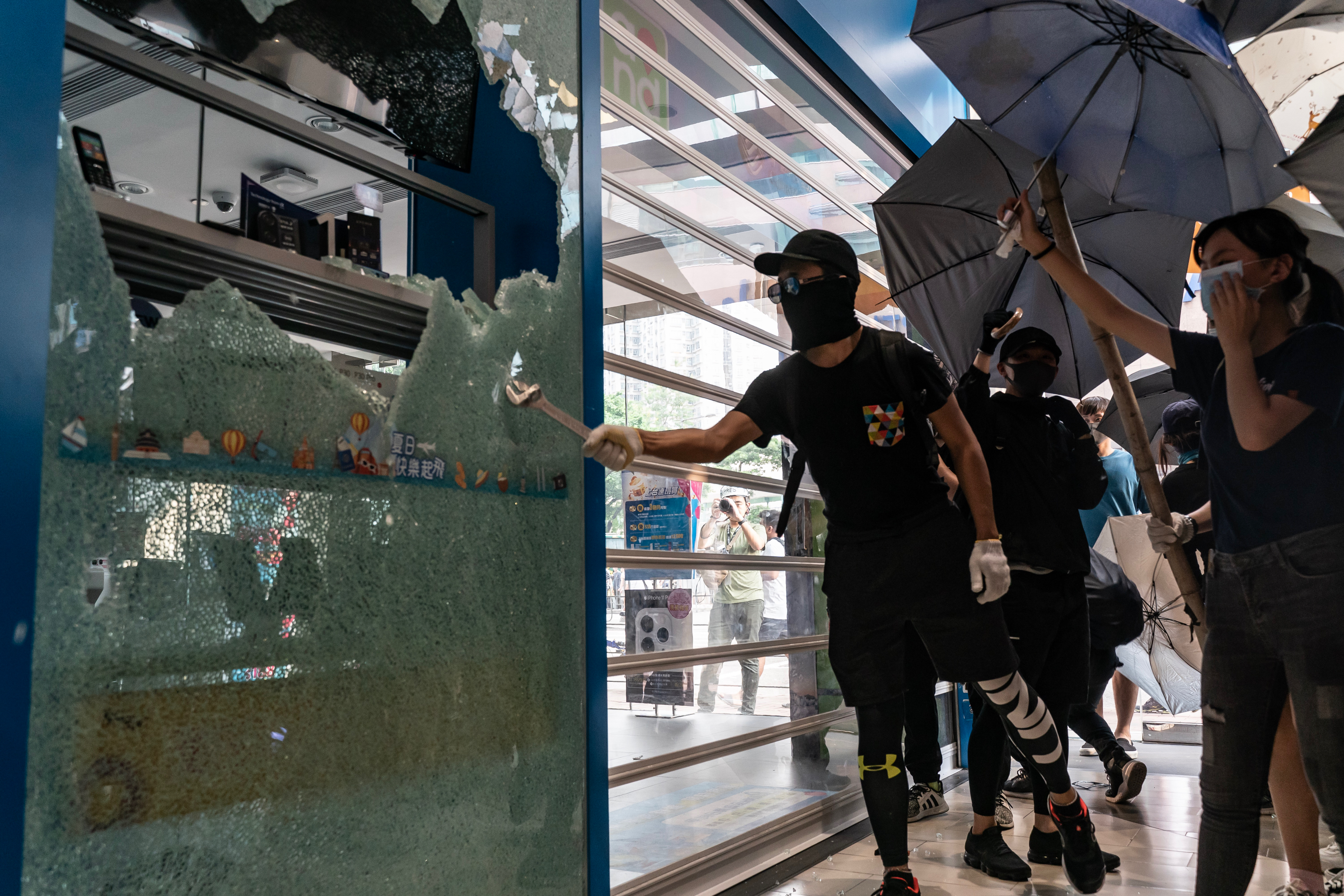 Pro-democracy protesters vandalize a China Mobile Ltd. store at Sheung Shui district on October 5, 2019 in Hong Kong, China.