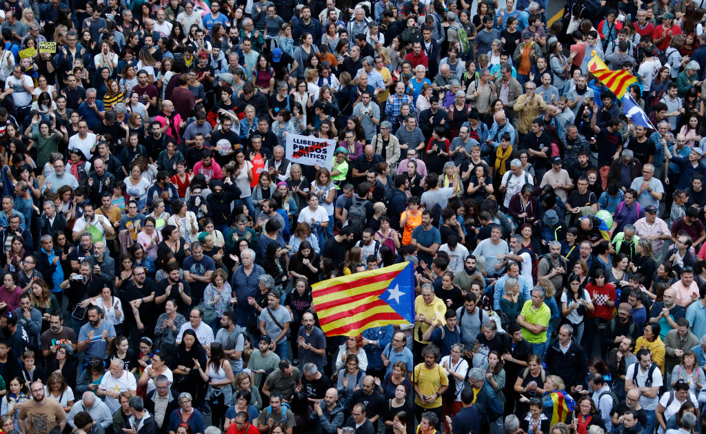 A large group of people gather in front of the Delegation of the Spanish Government on October 20, 2019 in Barcelona, Spain, following a week of protests over the jail sentences given to separatist politicians by Spain's Supreme Court.